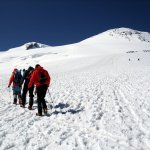 Walking slowly up Elbrus with West Peak (5642m) left and East Peak (5621m) right
