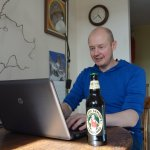 Here I am tapping away at my book. I'm not allowed the beer until I've written at least 2,000 words.