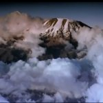 Kibo, Kilimanjaro's central peak, as picture during the film, with its familiar carpet of cloud below