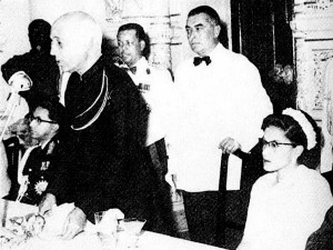 Indian Prime Minister Jawaharlal Nehru speaks at a banquet for Queen Ratna Devi of Nepal, with Boris standing behind