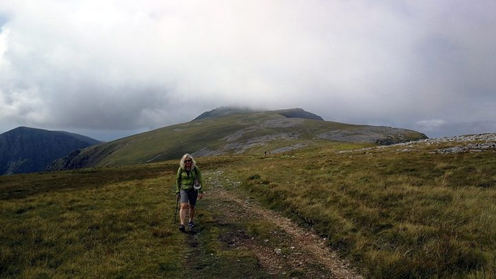 Edita on her way to Mynydd Moel, with Pen y Gadair behind