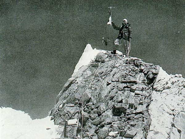 The classic shot of Gyalzen Norbu Sherpa on the summit of Manaslu, a shattered rock tower, after the first ascent (Photo: Toshio Imanishi)