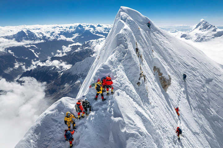 Climbers approach the fore-summit of Manaslu while others traverse beneath it to the main summit (Photo: Jackson Groves / Facebook)