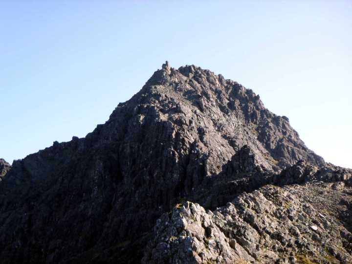 Sgurr nan Gillean from the col. The three chimneys can be seen at the base of the pyramid, roughly level with the col.