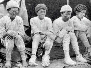 Four Sherpa survivors of the 1934 nightmare on Nanga Parbat - Da Thundup, Pasang Kikuli, Kitar and Pasang - taken by a member of the German team after they descended