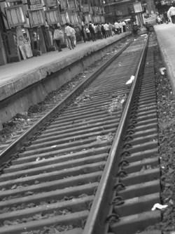 Mumbai train tracks by Alistair Mokoena