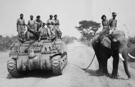 British_commander_and_Indian_crew_encounter_elephant_near_Meiktila