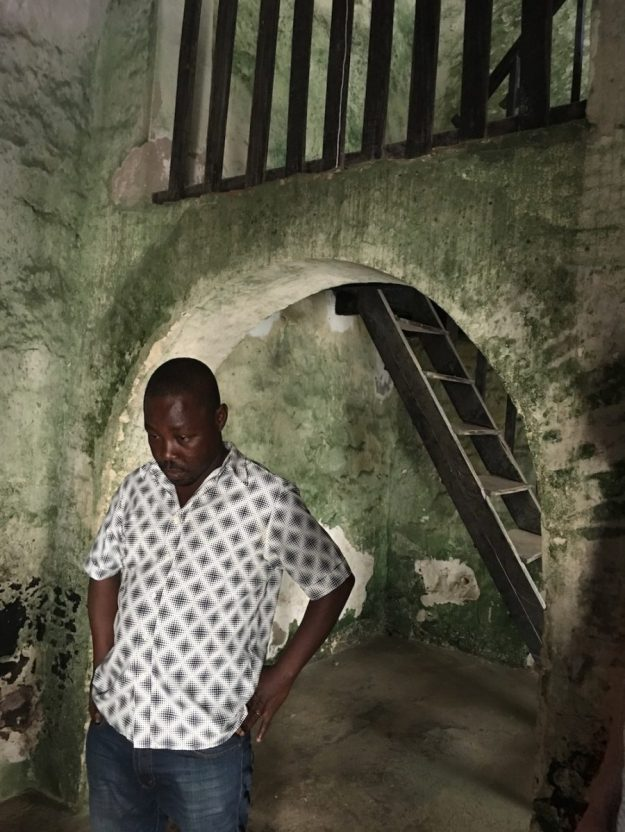 Elmina guide Philip contemplating the fate of countless.jpg