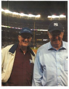 Steve Forbes and Mark Skousen at Yankee stadium, with Derek Jeter in the background
