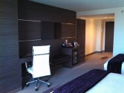 Another view of the desk, minibar and TV wall.