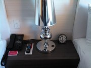 The nightstand with and old school clock.