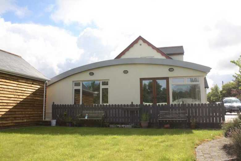 Double-ended extensions to a dormer bungalow - County Mayo