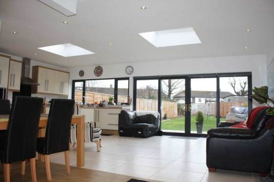 Interior showing extension to rear with extensive glazing, access to garden & rooflights