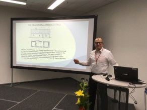 Mark Stephens presenting at 2018 Passivhaus Conference, Munich