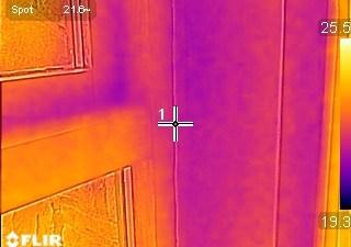 Thermal image photograph showing thermal bridge at window