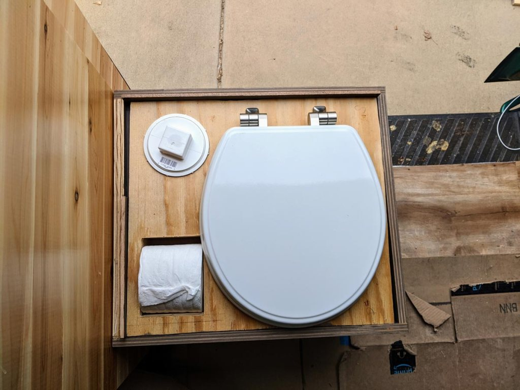 composting toilet under a seat maximizes space in a van layout