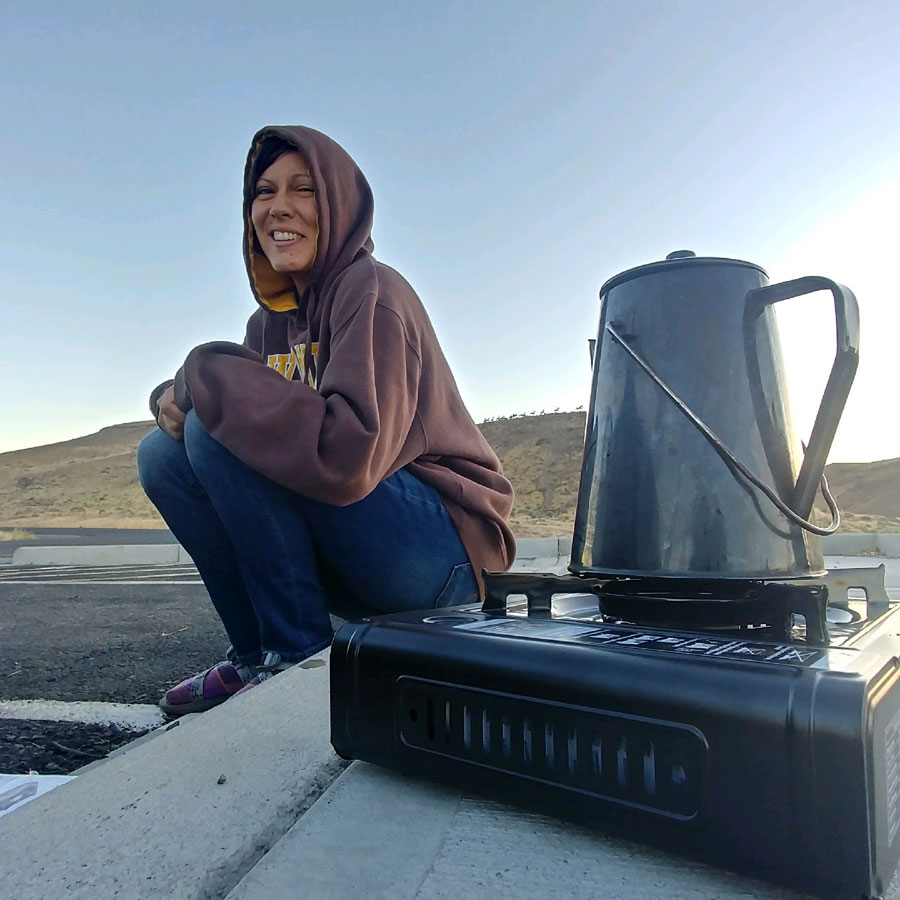 christina making coffee in a parking lot