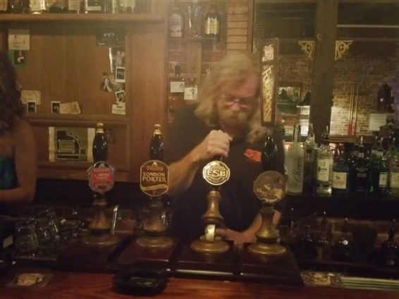 The owner, Richard pouring a beer at The Dirty Shame in Centro Ybor in Tampa, Florida