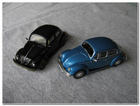 Photo #1 Whitebox, left, with visible passenger side mirror. Solido, right.