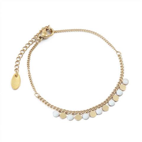 Bracelet ronds blancs et dorés en acier inoxydable.