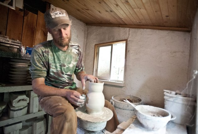 Ryan Dalman at work in his Wood Fired Pottery studio in Michigan's Upper Peninsula. (photo by Ron Caspi)