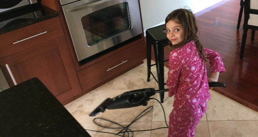 Zoey Vacuums the Kitchen