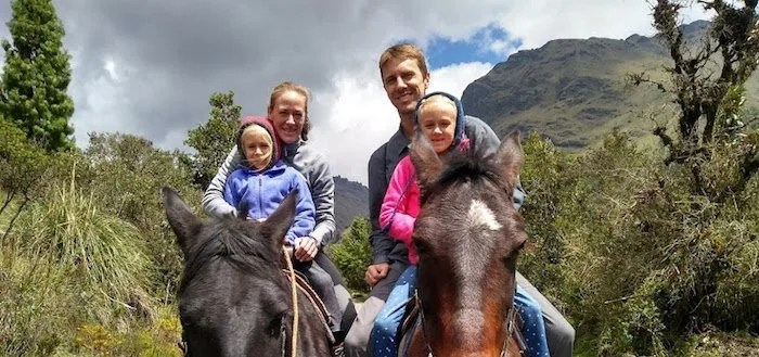 Chad Carson and family riding horses in Equador