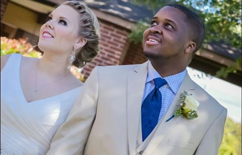 Michael Lacy and his wife Taylor on their wedding day