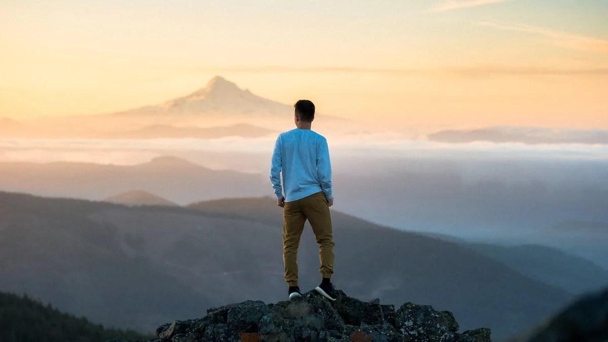 Man standing overlooking mountain