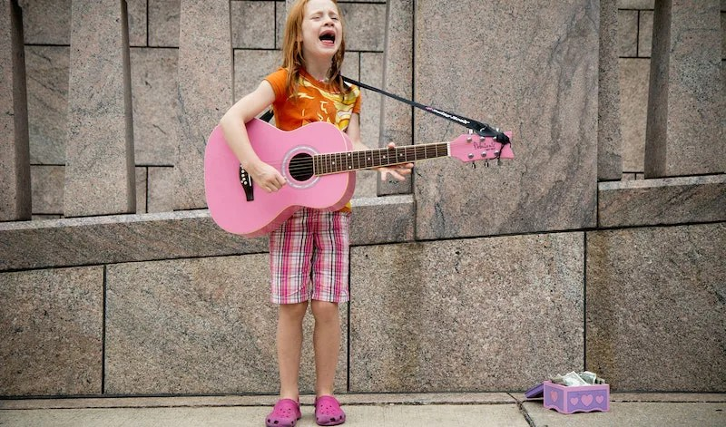 Girl singing for money
