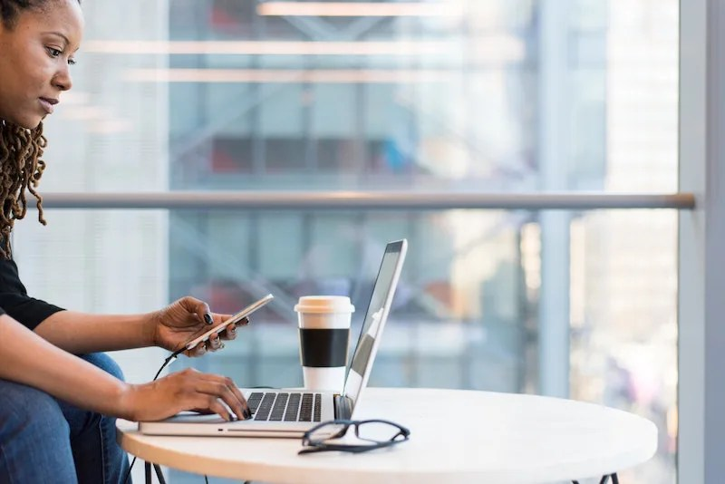 Woman typing into computer