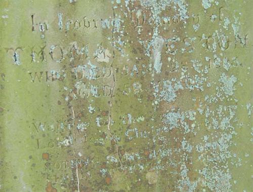 Gravestone with illegible writing
