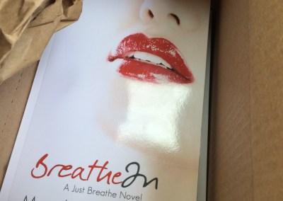 Paperback copy of Breathe In by Martha Sweeney