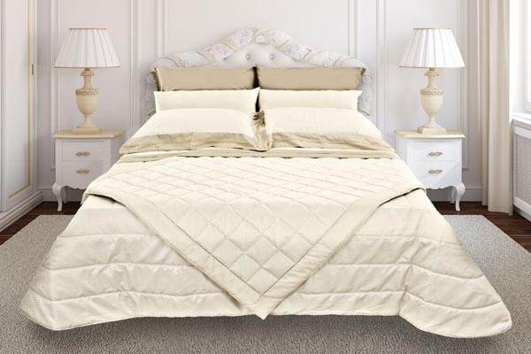 coordinato-letto-trapunta-trapuntino-scaldotto-lenzuola-panna-ramage-600x400