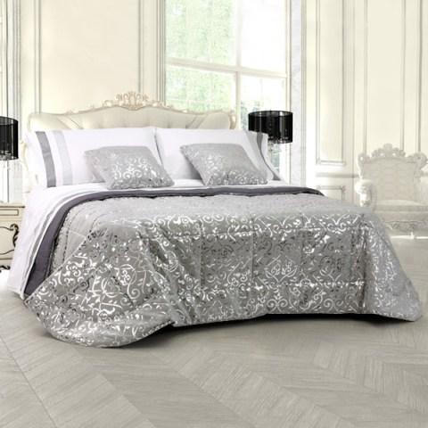 Trapunta matrimoniale invernale in alcantara grigio laminata argento con motivo floreale