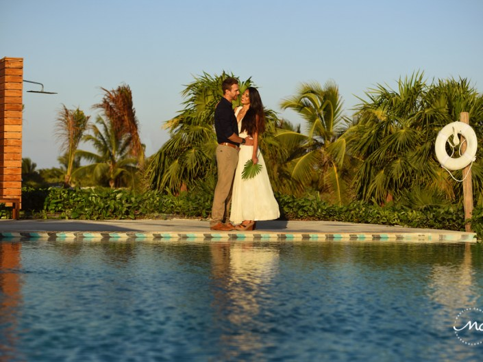 Bride and groom poolside portraits at Chable Maroma, Mexico. Martina Campolo Wedding Photography