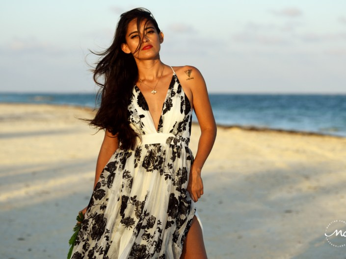Beach model in floral maxi dress at Maroma Beach, Mexico. Martina Campolo Photography