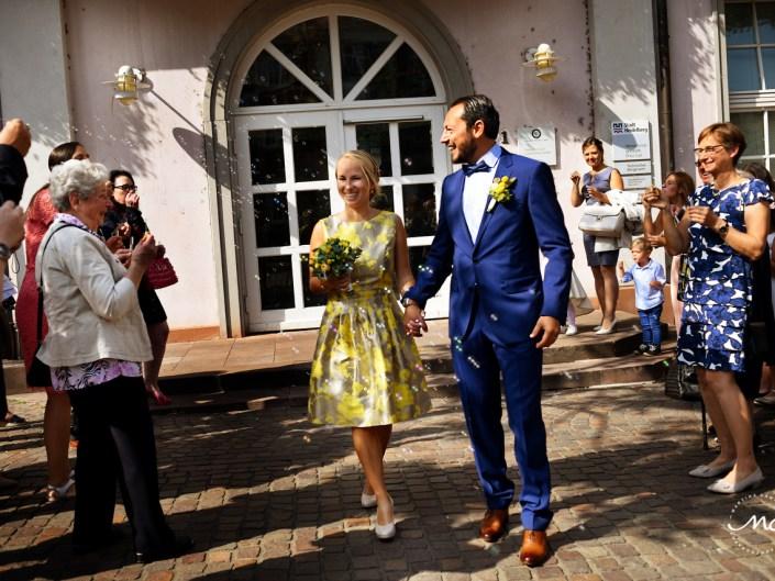 Bride and groom exit. Intimate German Wedding in Heidelberg. Martina Campolo Photography