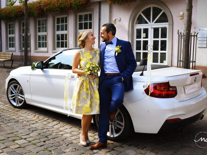 Newlyweds with Just Married Car. German Wedding in Heidelberg. Martina Campolo Photography