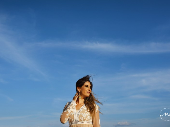 Sara Tamargo in romantic lace dress and perfect blue sky. Martina Campolo Riviera Maya Photography