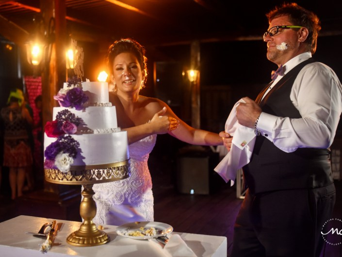Cake cutting. Now Sapphire Riviera Cancun destination wedding by Martina Campolo Photography