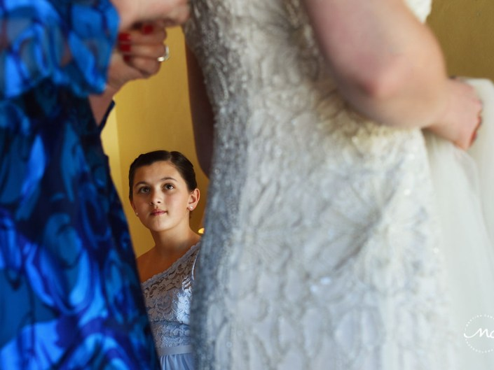 Girl watching bride getting dressed. Hacienda del Mar destination wedding in Mexico by Martina Campolo Photography