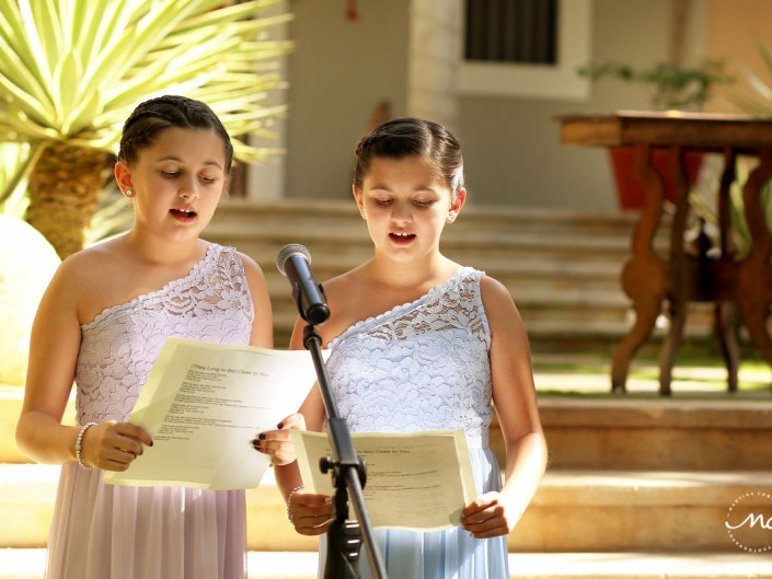 Girls sing for a wedding ceremony at Hacienda del Mar, Riviera Maya, Mexico. Martina Campolo Photography