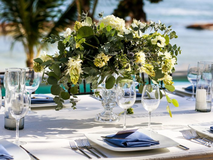 White and green floral centerpiece with clear vase at Hacienda del Mar Wedding in Mexico. Martina Campolo Photography