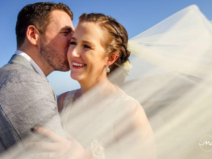 Closeup bride and groom portrait with wedding veil by Martina Campolo Riviera Maya Wedding Photography