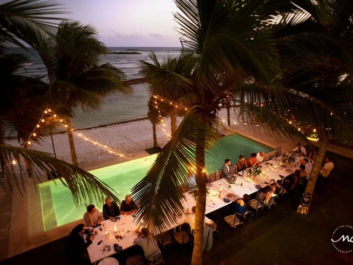 Aerial view of Hacienda del Mar poolside wedding reception with bistro lights in Mexico. Martina Campolo Photography