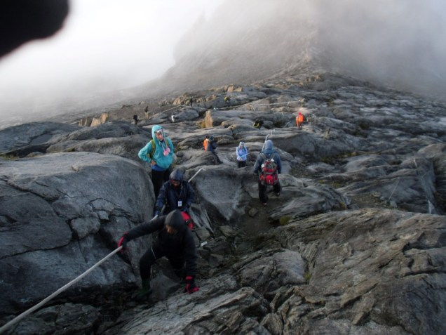 The view from the top... determined hikers climbing Mt Kinabalu in the very last stages.