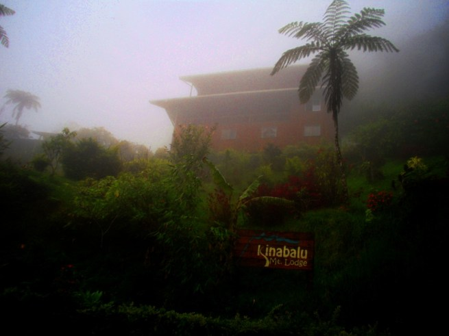 Kinabalu Mountain Lodge looming out of the mizzle.
