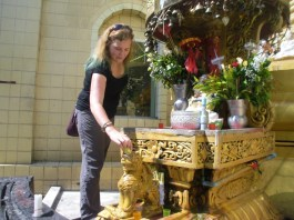 Me pouring water on the lion because I was born on a Tuesday - thanks to a friendly local who showed me what to do!