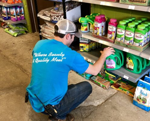 Employee restocking fertilizer - Martin's Home & Garden - Murfreesboro, TN